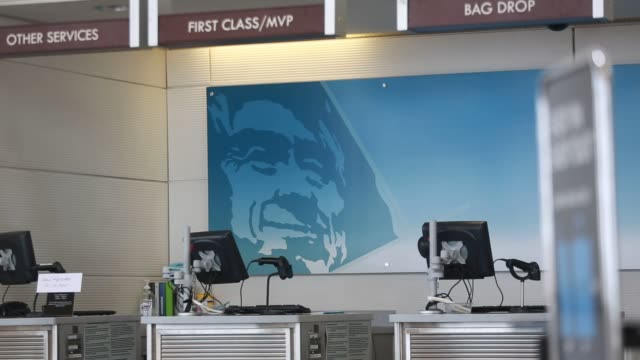 a virgin america inc checkin counter stands at ronald reagan national airport along with an alaska air group inc checkin counter in washington dc us... - ronald reagan washington national airport stock videos and b-roll footage