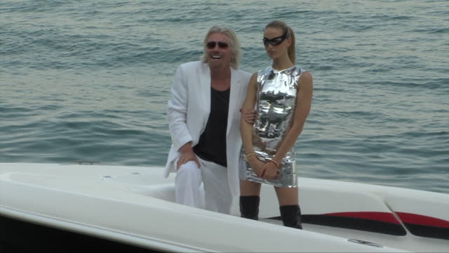virgin atlantic founder sir richard branson poses with model karolina kurkova in 'miami vice' sendup as part of press event to celebrate 25 years of... - karolina kurkova stock videos and b-roll footage