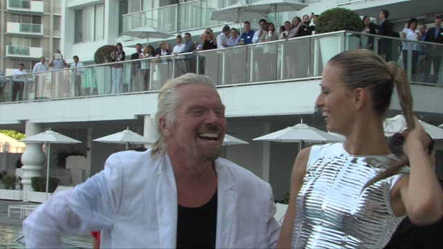 virgin atlantic founder sir richard branson swims in pool with model karolina kurkova as part of press event to celebrate 25 years of flying from... - karolina kurkova stock videos and b-roll footage