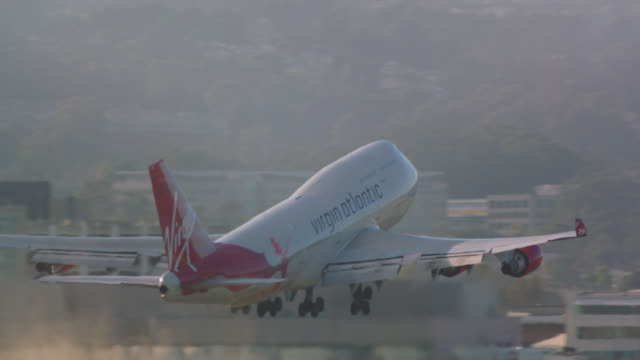 Virgin Atlantic jumbo 747 enters frame just prior to lift-off on departure from SFO
