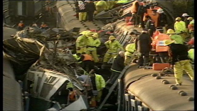 virgin train crashes in cumbria tx clapham junction emergency services and train wreckage at scene of clapham rail disaster - train crash stock videos and b-roll footage
