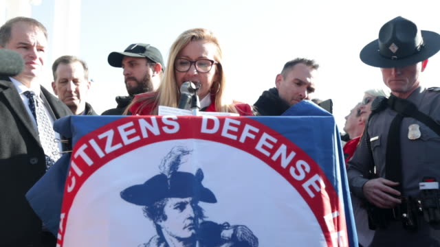 virginia citizens defense league president philip van cleave, and virginia state sen. amanda chase address a gun rights rally on capitol square near... - virginia us state stock videos & royalty-free footage