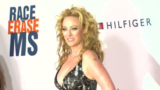 virginia madsen at the the 18th annual race to erase co-chaired by nancy davis and tommy hilfiger at los angeles ca. - virginia madsen stock videos & royalty-free footage