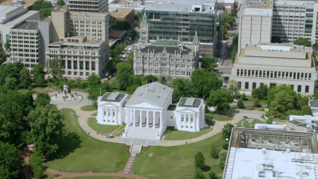 WS AERIAL POV Virginia State Capitol building with cityscape / Richmond, Virginia, United States