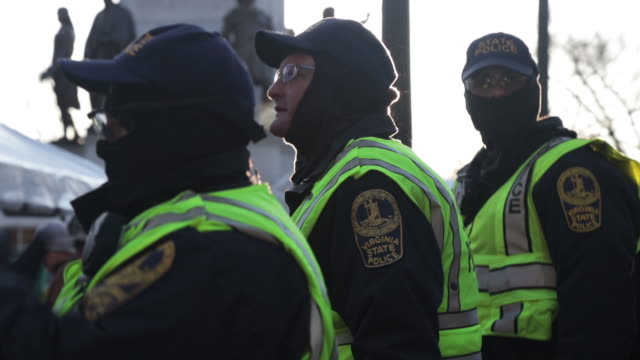 virginia state police stand watch over a security checkpoint as thousands of gun rights advocates attend a rally organized by the virginia citizens... - virginia us state stock videos & royalty-free footage