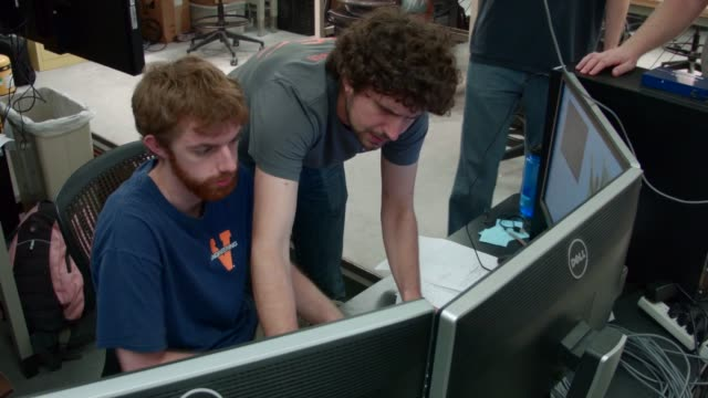 Virginia Tech mechanical and electrical engineering students work all night to test the ESCHER robot the TREC Lab May 27 2015 in Blacksburg Virginia...