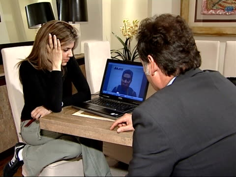 vídeos de stock e filmes b-roll de controversy over broadcast of video made by gunman england london int dr linda papadopoulos with reporter looking at seunghui video on laptop computer - virginia polytechnic institute and state university