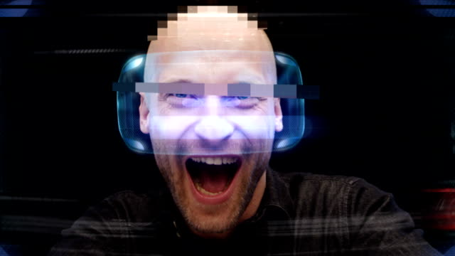 virtual gaming. young man having fun in virtual world - realtà aumentata video stock e b–roll