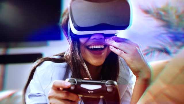 virtual playing with game controller - geek stock videos & royalty-free footage