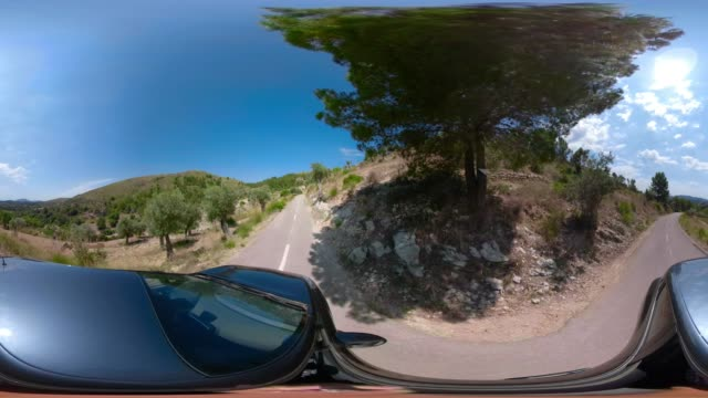 Virtual reality 360 degree view of car driving on mountain hairpin turns in Sierra de Tramuntana of Balearic Islands Majorca / Spain