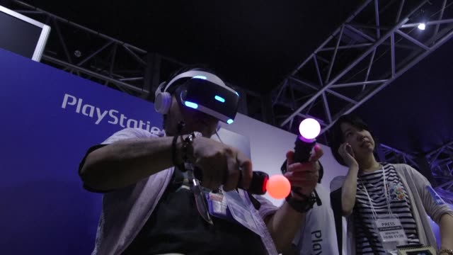 virtual reality gadgets and games take the centre stage at the tokyo game show - television game show stock-videos und b-roll-filmmaterial