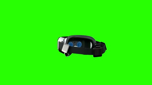 vidéos et rushes de casque de réalité virtuelle tournant autour sur l'écran vert - réalité virtuelle