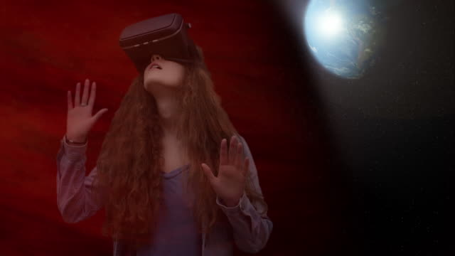 Virtual reality, space, girl wearing VR glasses. Cyberspace.
