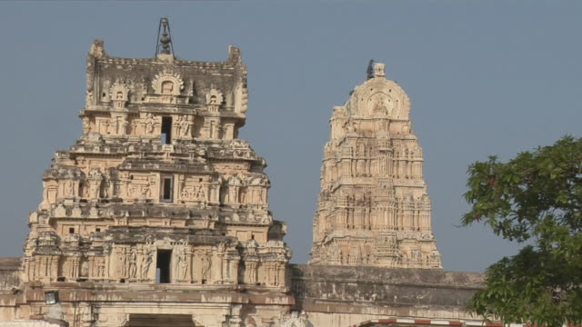 ws virupaksha temple, which is dedicated to the goddess pampa and her consort shiva/ hampi, karnataka, india - temple building stock videos & royalty-free footage