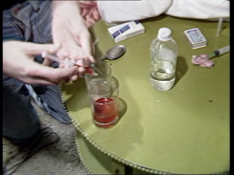 virus amongst drug addicts in scotland; scotland: edinburgh: wester hailes: ext gv housing estate zoom in int ** sound overlay: drug addict talking... - heroin stock videos & royalty-free footage