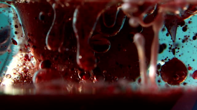 virus close up - food coloring stock videos and b-roll footage