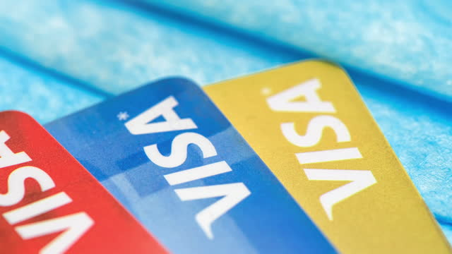 visa credit cards over a protective face mask on december 23, 2020; in toronto, canada. the image is a concept for illustrative editorial usage. it... - interest rate stock videos & royalty-free footage