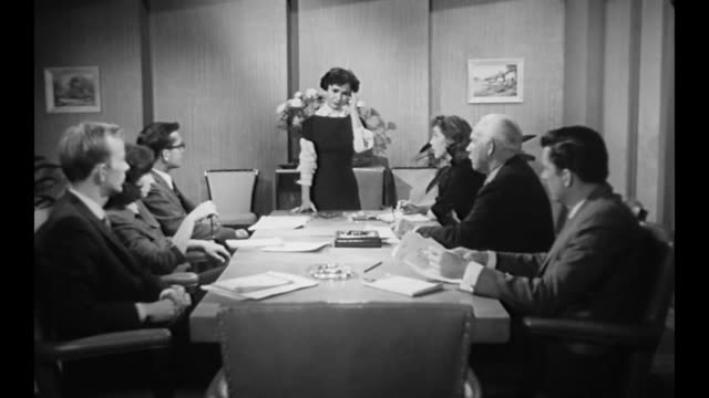 1959 visibly sick, female ceo (susan cabot) runs ad campaign meeting - gereiztheit stock-videos und b-roll-filmmaterial