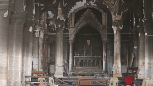 vídeos y material grabado en eventos de stock de vision of the destruction of the grand immaculate church in qaraqosh just east of mosul shortly after the iraqi army back by kurdish forces liberated... - cristianismo
