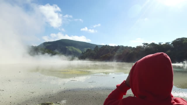 visit by a child of geothermal reserve with colored waters - wildlife reserve stock videos & royalty-free footage