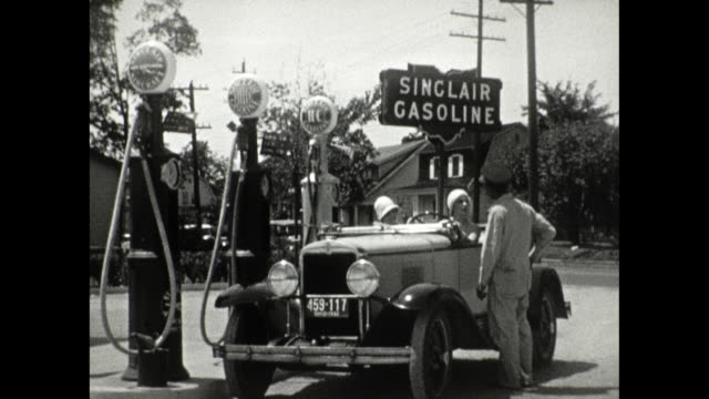 1930 visit to a sinclair gas station - gas station attendant stock videos and b-roll footage