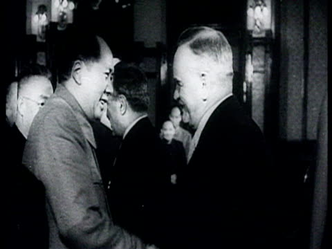 visit to china, khrushchev, mao, chou en-lai, bulganin , forbidden city in beijing, mao and khrushchev shaking hands, chinese parade for the 5th... - mao tse tung video stock e b–roll