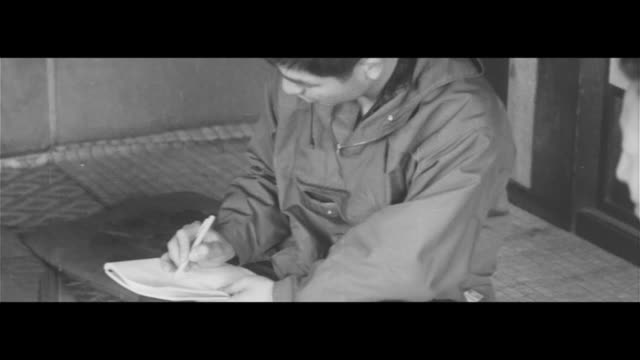 visiting ainu villages/ainu town investigators interview ainu elder investigators interview elderly ainu carving at a craft workshop examining 3000... - asian tribal culture stock videos and b-roll footage
