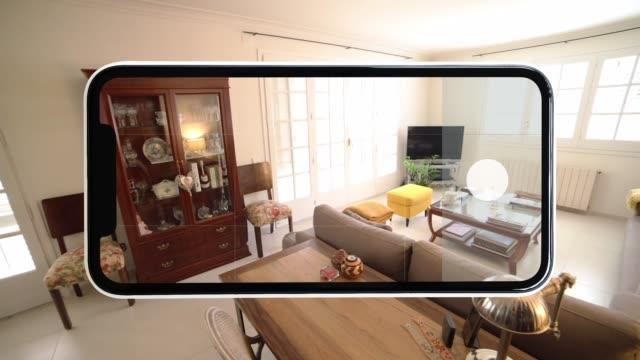 vídeos y material grabado en eventos de stock de visiting home interior using mobile phone with virtual reality technology in 360º. - panorámica