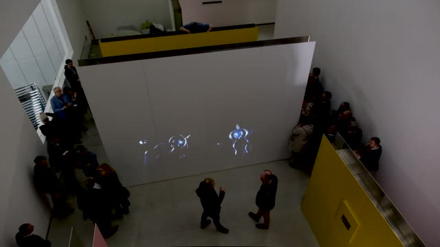 visiting journalists walk past a dance presentation on a screen at the new bauhaus-museum weimar on april 04, 2019 in weimar, germany. the museum is... - weimar video stock e b–roll