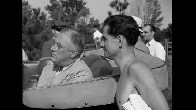 fdr visiting softball game sitting in car speaks with lowell thomas while a band plays around them franklin d roosevelt at outdoor party on january... - eastern usa stock videos and b-roll footage