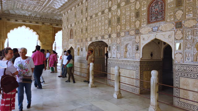 visiting the amer fort or amber fort near jaipur in rajasthan. india. south asia - produced segment stock videos & royalty-free footage