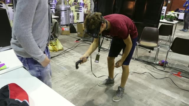 a visitor explores a virtual reality landscape with vr goggles at the 2016 berlin maker faire on october 1 2016 in berlin germany the maker faire... - schutzbrille stock-videos und b-roll-filmmaterial