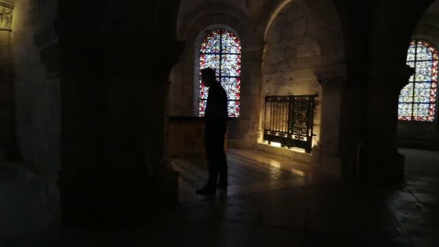 visitor in the crypt at the basilica of saint-denis in the outskirts of paris on july 5, 2020 in saint denis, france. the church houses the remains... - crypt stock videos & royalty-free footage