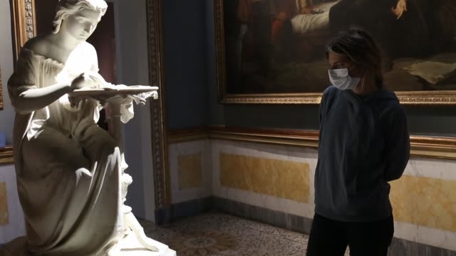 visitor in the rooms of the gam on may 26, 2020 in milan, italy. many italian businesses have been allowed to reopen, after more than two months of a... - museum video stock e b–roll