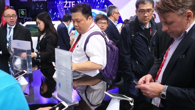 A visitor inspects a ZTE Nubia Z7 smartphone in the ZTE Corp pavilion at the Mobile World Congress in Barcelona Spain on Tuesday March 3 2015