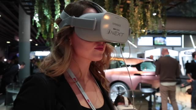 a visitor is seen using an experience vr virtual reality of bmw vision inext car concept is seen during the mobile world congress 2019 in barcelona... - bmw stock videos & royalty-free footage