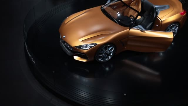 A visitor photographs a BMW Z4 electric concept automobile manufactured by Bayerische Motoren Werke AG during the first media preview day of the IAA...