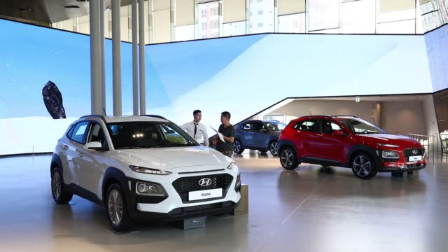 a visitor sits inside a hyundai motor co kona sport utility vehicle at the hyundai motorstudio showroom in goyang south korea on friday july 14 an... - goyang stock videos and b-roll footage