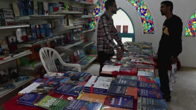 a visitor talks to a participant of a book exhibition amid lack of visitors on september 23 2020 in sana'a yemen the first book exhibition has opened... - participant stock videos & royalty-free footage