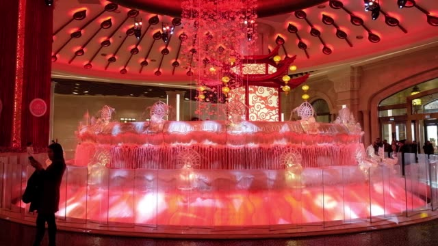 visitor uses a smartphone to photograph a light show displayed at a water fountain at the galaxy macau casino and hotel, developed by galaxy... - macao stock videos & royalty-free footage