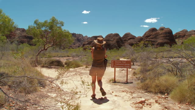 WS PAN Visitor walking on cathedral gorge walk trail national park  / Purnululu, Western Australia, Australia