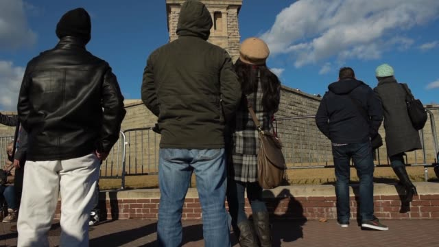 stockvideo's en b-roll-footage met visitors and tourists riding the liberty island ferry in new york ny pose for photographs with the statue of liberty standing in the background on a... - passagiersboot