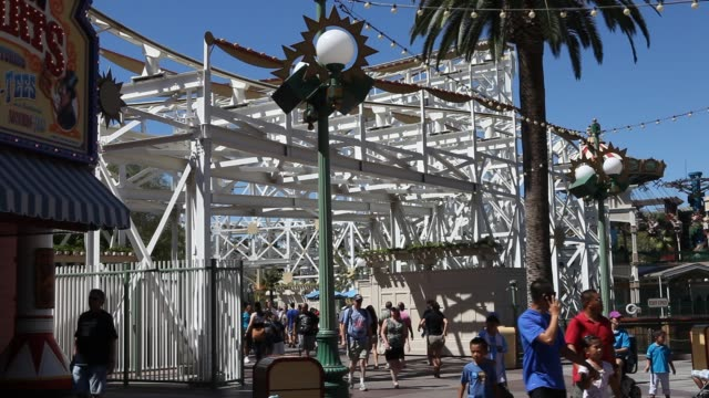 visitors are enjoying the day at paradise pier in disney california adventure park which is part of the entertainment resort disneyland in anaheim... - anaheim california stock videos & royalty-free footage