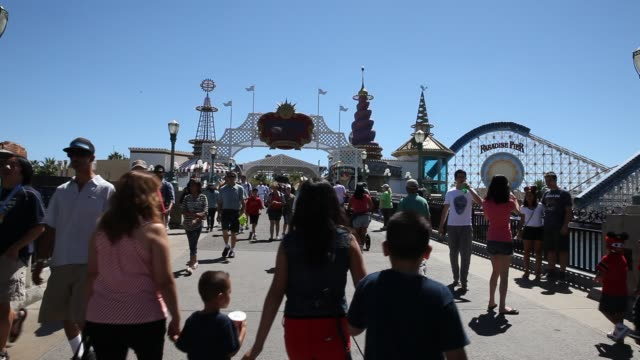 september 02: visitors are walking on a bridge, on the right side paradise pier in disney california adventure park, which is part of the... - anaheim california stock videos & royalty-free footage
