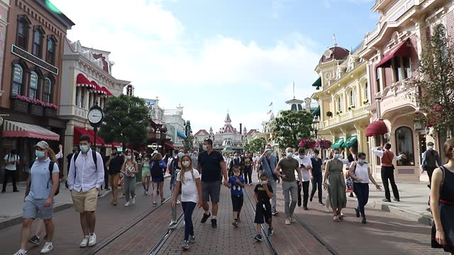 visitors are welcomed by disney cast members as they walk on the main street as disneyland paris parks reopen to the public on june 17, 2021 in... - street name sign stock videos & royalty-free footage