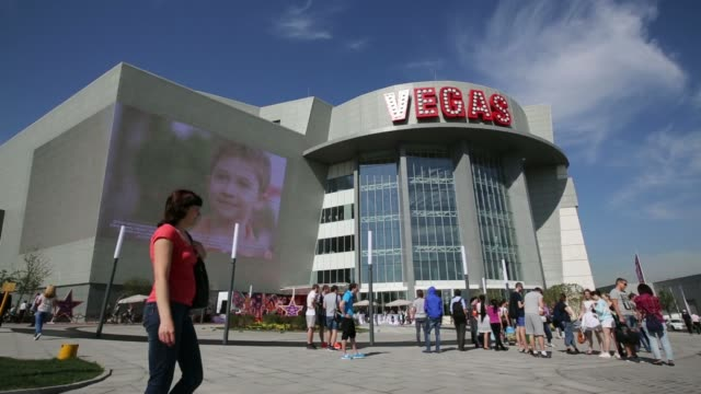 Visitors arrive at the entrance to the new Vegas shopping mall operated by Crocus Group on its opening day in Moscow Russia on Wednesday June 4 A...