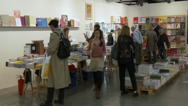 visitors at bookstore of miart, a fair of modern and contemporary art on april 10, 2016 in milan . - miart stock videos & royalty-free footage
