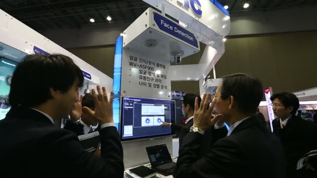 visitors at the panasonic corp booth at the international security conference expo in goyang south korea on wednesday march 12 panasonic signage... - goyang stock videos and b-roll footage