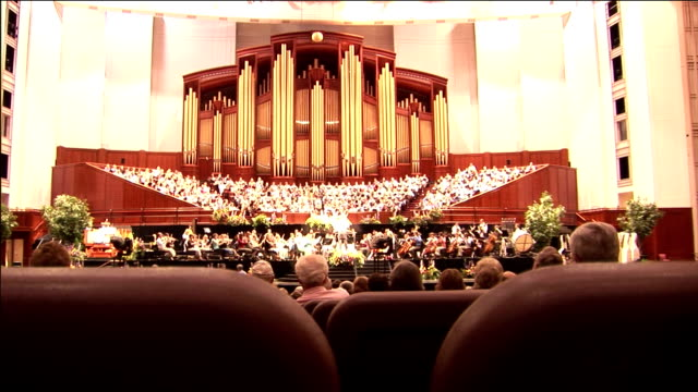 visitors attend a performance of the mormon tabernacle choir. - mormonism stock videos & royalty-free footage