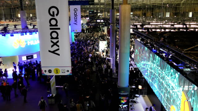 visitors attend to the mobile world congress 2017 on the opening day of the event at the fira gran via complex on february 27 2017 in barcelona spain... - exhibition stock videos and b-roll footage